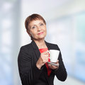 Attractive woman years with cup of coffee Stock Photography