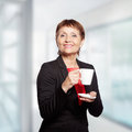 Attractive woman years with cup of coffee Stock Photos