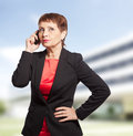 Attractive woman years old with a mobile phone Royalty Free Stock Images