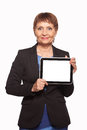 Attractive woman years old with a tablet in hands on white background Royalty Free Stock Images