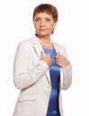 Attractive woman years in a white jacket isolated on background Royalty Free Stock Image