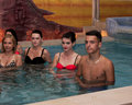 Attractive women's working during shooting music video clip wagrawiec poland june in the pool of the polish disco band jurad Royalty Free Stock Photo