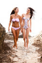 Attractive Women Wearing Bikinis Walking Royalty Free Stock Photography