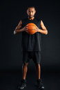 Attractive young african man with basket ball Royalty Free Stock Photo
