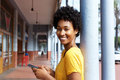 Attractive young african woman holding a mobile phone Royalty Free Stock Photo