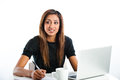 Attractive young asian indian teenage woman studying with lapto a non branded generic laptop Royalty Free Stock Image