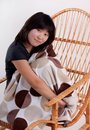 Attractive young Asian woman sitting in the rockin Stock Photography