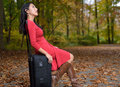 Attractive young Asian woman with suitcase Stock Photo