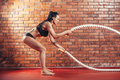 Attractive young and athletic girl using training Royalty Free Stock Photo