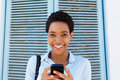 Attractive young black woman holding mobile phone Royalty Free Stock Photo