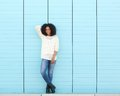 Attractive young black woman smiling outdoors full length portrait of an Stock Photos