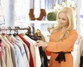 Attractive young blonde woman looking clothes shop Royalty Free Stock Images
