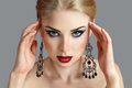 Attractive young blonde woman ornate earring Stock Photo