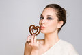 Attractive young brunette with chocolate heart. Royalty Free Stock Photos