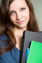 Attractive young brunette student girl. Royalty Free Stock Photography