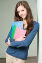 Attractive young brunette student girl. Royalty Free Stock Images