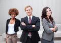 Attractive young business group standing together at office Stock Images