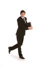 Businessman walking with a folder Royalty Free Stock Photo