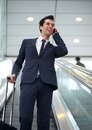 Attractive young businessman talking on mobile phone portrait of a Stock Images