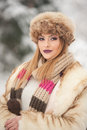 Attractive young caucasian adult with brown fur cap beautiful blonde girl with gorgeous lips and eyes wearing fur hat outdoor shot Stock Photo
