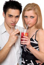 Attractive young couple with cocktails. Isolated Royalty Free Stock Photo