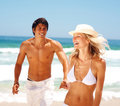 Attractive young couple having fun at the beach Stock Photo
