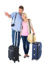 Attractive young couple ready to go on vacation white background Royalty Free Stock Image