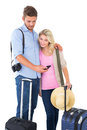 Attractive young couple ready to go on vacation white background Stock Photo
