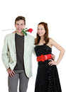 Attractive young couple with rose in the mouth isolated on the white background Royalty Free Stock Photography