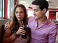 Attractive Young Couple Sharing Soda at Restaurant Royalty Free Stock Photo