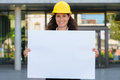 Attractive young female architect holding a sign Royalty Free Stock Photo