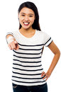 Attractive young female pointing you out charming at against white background Stock Photo