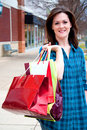 Attractive Young Female on Shopping Spree Stock Photos