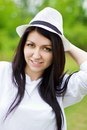 Attractive young female wearing a straw hat Stock Photography