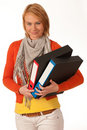 Attractive young girl carries file folders Royalty Free Stock Photography