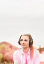 Attractive young girl enjoying music in a sunny day outside Royalty Free Stock Photo