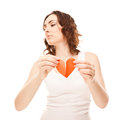Attractive young girl holding broken paper red valentine heart Stock Photo