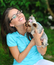 Attractive young girl playing with her yorkshire terrier puppy o Royalty Free Stock Photo
