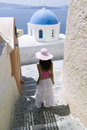 Attractive young Greek woman on the streets of Oia, Santorini Stock Photos