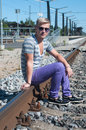 Attractive young guy on rails Royalty Free Stock Photo
