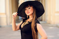 Attractive young lady in a black hat Royalty Free Stock Photography