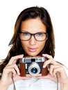 An attractive young lady holding a camera on white Royalty Free Stock Images