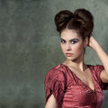 Attractive young lady in pink dress and funny styling posing on Royalty Free Stock Photo