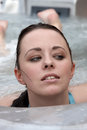 An attractive young lady in a pool Stock Photo