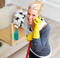 Attractive young lady taking a break from cleaning Stock Photo