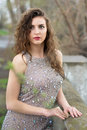 Attractive young lady wearing splendid grey dress with rhinestones Royalty Free Stock Images
