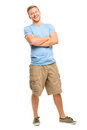 Attractive young man with arms folded on white background Royalty Free Stock Image