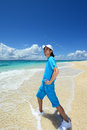 Attractive young man on the beach enjoy sunlight picture of a a beautiful sea in okinawa Stock Photography