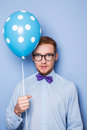Attractive young man with a blue balloon in his hand. Party, birthday, Valentine Royalty Free Stock Photo
