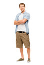 Attractive young man in casual clothing white background full length smiling Stock Photography